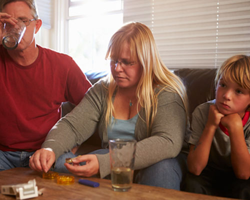 parents drinking and drugging around young son