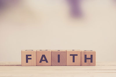 Faith spelled in wooden blocks