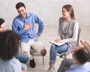 12-step-meeting-with-people-sitting-in-a-circle