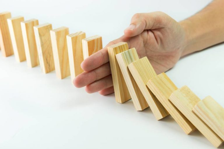 A hand stopping a row of falling blocks