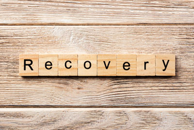 """""""Recovery"""" Spelled in wooden blocks"""